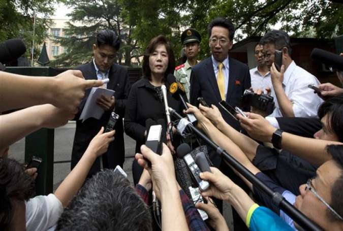 Choe Son-hui, deputy director general of the Department of US Affairs at the North Korean Foreign Ministry (C), speaks to reporters. (Photo by AP)