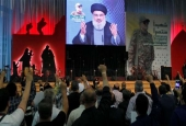 Hezbollah chief Sayyed Hassan Nasrallah addresses Lebanese people from a screen in Beirut