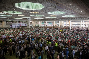 Supporters of Iranian presidential candidate Ebrahim Raisi gather during a campaign meeting at the Mosalla mosque in Tehran, Iran, May 16, 2017.