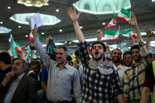 Supporters of Iranian presidential candidate Ebrahim Raisi chant slogans during a campaign meeting at the Mosalla mosque in Tehran, Iran, May 16, 2017.