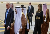 US President Donald Trump (L) is welcomed by Saudi King Salman (2nd-L) upon arrival at King Khalid International Airport in Riyadh on May 20, 2017, followed by First Lady Melania Trump. (Photo by AFP)