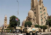 This file photo shows Egyptian army and police vehicles standing guard outside Saint Mark's Coptic Orthodox Cathedral in central Cairo, Egypt. (By AFP)