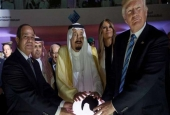 "US President Donald Trump (R), his Egyptian counterpart Abdel Fattah el-Sisi (L) and Saudi King Salman bin Abdulaziz Al Saud simultaneously touch a glowing orb to inaugurate an ""anti-extremism"" center in Riyadh, Saudi Arabia, May 21,2017."