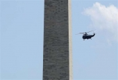 Marine One, with US President Donald Trump aboard, flies by the Washington Monument May 19, 2017 in Washington, DC. (Photo by AFP)