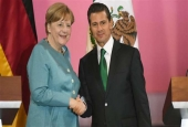 German Chancellor Angela Merkel (L) and Mexican President Enrique Pena Nieto shake hands at the Palacio Nacional in Mexico City on June 9, 2017. (Photo by AFP)