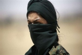 A member of the so-called Syrian Democratic Forces (SDF), made up of an alliance of Kurdish and Arab troops, stands some two kilometers from the al-Meshleb neighborhood of Raqqah on June 7, 2017. (Photos by AFP)