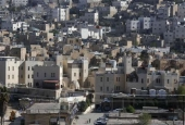 Israeli settlement of Abraham Avino in the center of the Old City of the Palestinian city of al-Khalil.jpg