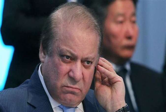 This file photograph taken on June 9, 2017, shows Pakistani Prime Minister Nawaz Sharif adjusting his earpiece as he attends a Shanghai Cooperation Organization (SCO) Summit in Kazakhstan. (Photo by AFP)