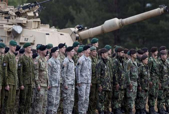 Military contingents from Lithuania, US and Portugal, attend an opening ceremony for the Iron Wolf 2017 drills at the training range in Pabrade, north of the capital Vilnius, Lithuania, June 12, 2017. (Photo by AP)