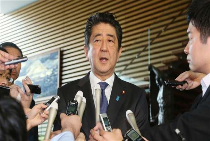 Japanese Prime Minister Shinzo Abe speaks on the passage of the anti-terror law while being surrounded by journalists, at his official residence in Tokyo, Japan, June 15, 2017. (Photo by AFP)