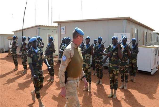 Division General Jean-Paul Deconinck of the Belgian Army reviews UN troops as he arrives in Gao on April 13, 2017 to take command of the MINUSMA (United Nations Multidimensional Integrated Stabilization Mission in Mali). (Photo by AFP)