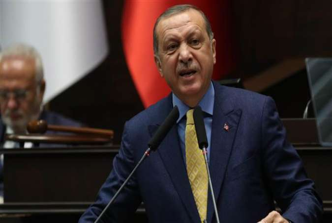 Turkish President Recep Tayyip Erdogan delivers a speech during the AK Party