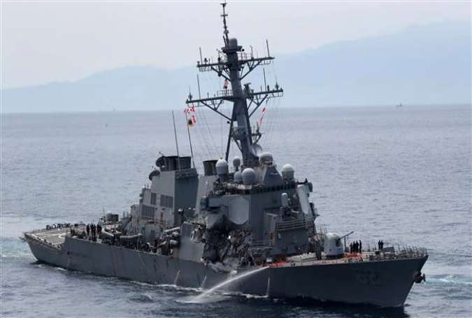 This picture shows the guided missile destroyer USS Fitzgerald off the Shimoda coast after it collided with a Philippine-flagged container ship on June 17, 2017. (Photo by AFP)