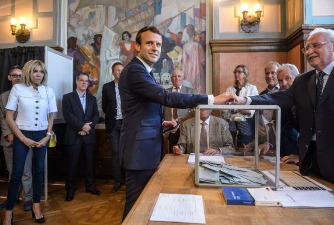 Runoff parliamentary elections start in France, Macron's party projected to win