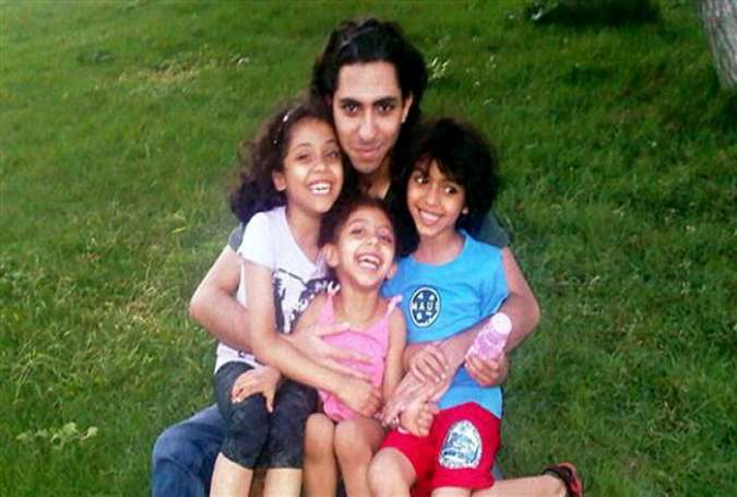 Saudi blogger Badawi's kids urge his release on 5th imprisonment anniv.
