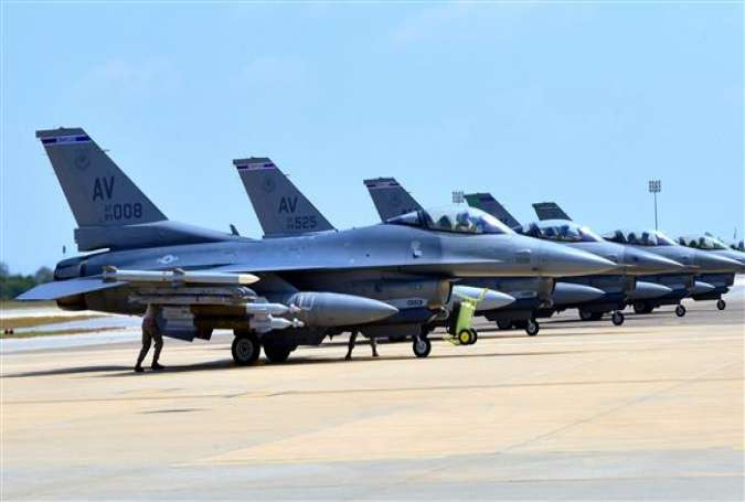This US Air Force handout photo, taken on August 9, 2015, shows F-16 Fighting Falcons sitting on the tarmac at the Incirlik Air Base in Turkey, where they are deployed to support coalition operations in Syria and Iraq. (Via AFP)