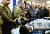 Netanyahu shaking hands with a wounded Takfiri militant at an Israeli field hospital in Syria's occupied Golan Heights