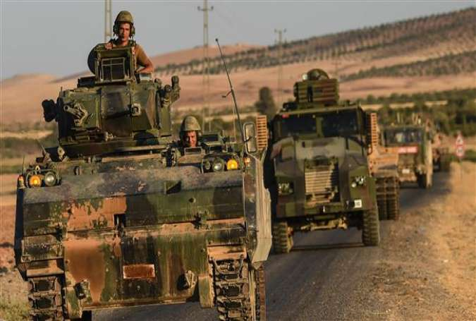 This file photo taken on September 02, 2016 shows Turkish soldiers driving back to Turkey from the Syrian-Turkish border town of Jarablus. (Photos by AFP)