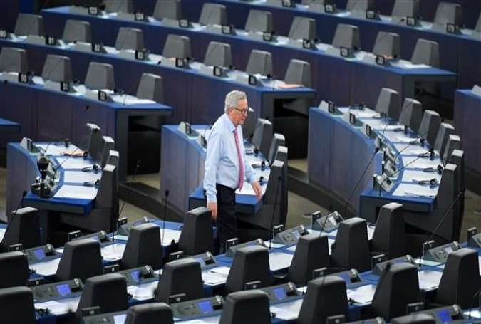 This file photo taken on May 17, 2017 shows EU Commission president Jean-Claude Juncker walking through the Chamber before a debate on the conclusions of the last European Council, at the European Parliament in Strasbourg, eastern France. (Photo by AFP)