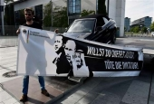 "Activists against the up-coming G20 summit present a Mercedes car with a banner featuring (L-R) Turkish President Recep Tayyip Erdogan, Russian President Vladimir Putin and Saudi King Salman bin Abdulaziz reading ""Do you want this car? Kill dictatorship"" in front of the Chancellery in Berlin on July 3, 2017. (Photos by AFP)"