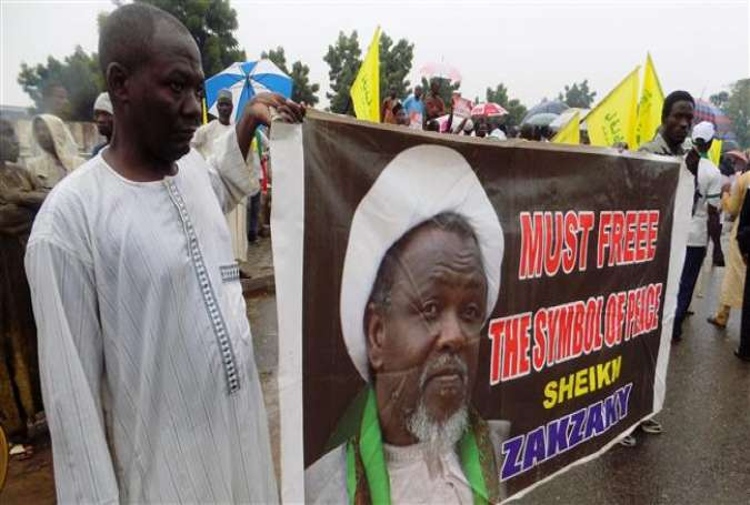 Protesters from the Islamic Movement in Nigeria (IMN) are seen holding a banner with a photograph of detained Shia cleric Sheikh Ibrahim Zakzaky, in the northern Nigerian city of Kano, on August 11, 2016. (Photo by AFP)