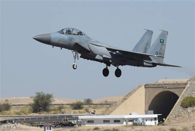 This photo taken on November 16, 2015 shows a Saudi F-15 fighter jet landing at a military airbase, some 880 kilometers from the capital Riyadh, as the Saudi army conducts operations over Yemen. (Photo by AFP)