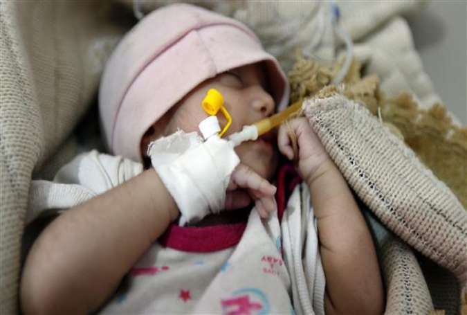 A Yemeni infant suspected of being infected with cholera receives treatment at a hospital in Sana