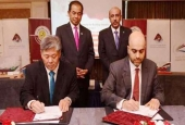 The representatives of MWANI Qatar and Malaysian shipbuilding companies signing an agreement