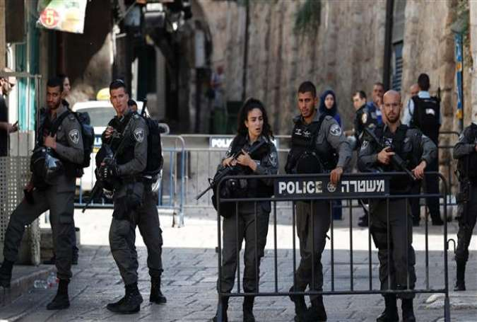 Israeli forces stand guard at one of the entrances to the al-Aqsa Mosque compound in the Old City of Jerusalem al-Quds on July 14, 2017, following a shooting. (Photo by AFP)