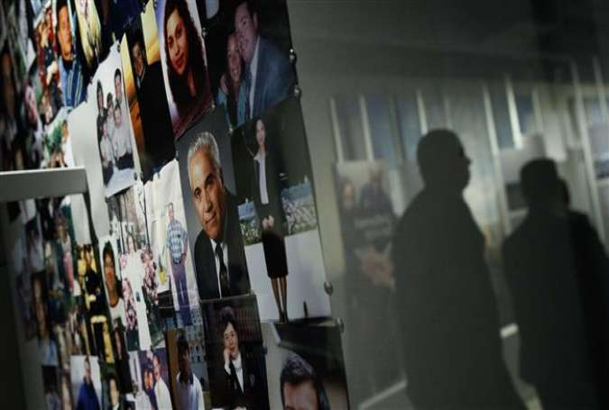 Photographs of 9/11 victims are displayed in a room in the new 9/11 Tribute Museum, June 13, 2017 in New York City. (Getty Images)