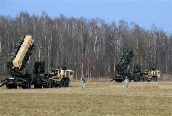 This picture taken on March 21, 2015 shows US troops from the 5th Battalion of the 7th Air Defense Regiment emplace a launching station of the Patriot air and missile defense system at a test range in Sochaczew, Poland. (Photos by AFP)