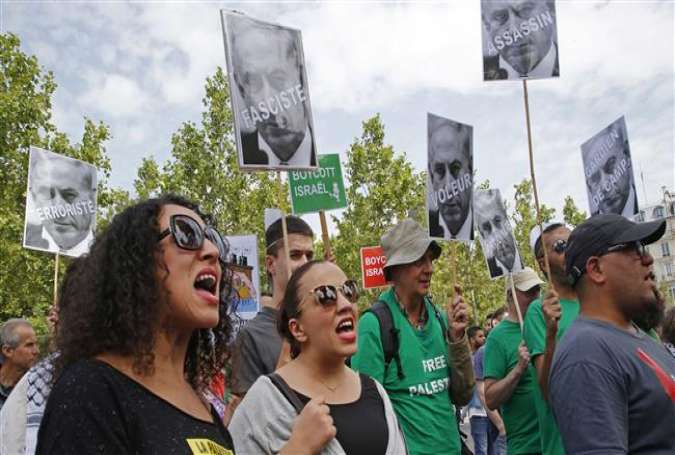 Activists protest Israeli premier's planned visit to France