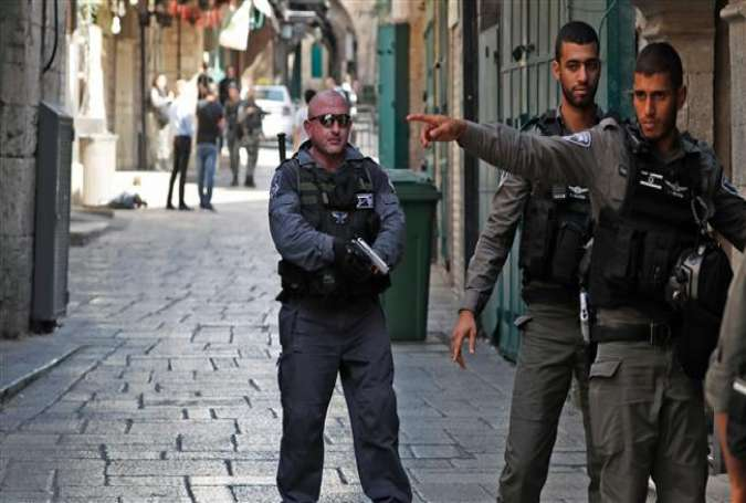 Israeli forces stand guard at one of the entrances to the al-Aqsa Mosque compound in Jerusalem al-Quds