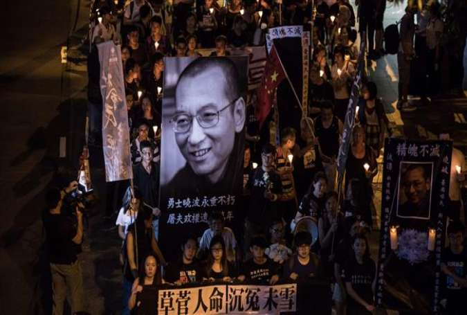 People attend a candlelight march for the late Chinese Nobel laureate Liu Xiaobo, in Hong Kong, July 15, 2017. (Photo by AFP)