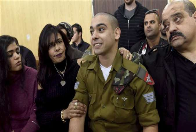 In this January 24, 2017 photo, Israeli soldier Elor Azaria attends a sentencing hearing in the military court surrounded by his family, in Tel Aviv. (Photo by AP)
