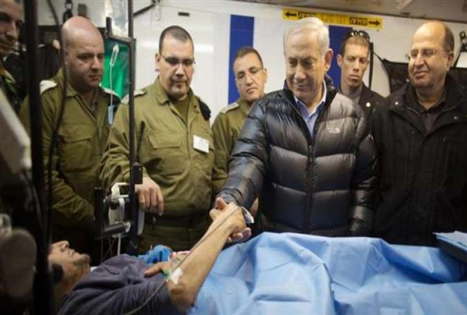 Israeli regime's PM Netanyahu visiting a wounded Takfiri terrorists at a facility run by the regime in the occupied Golan Heights.