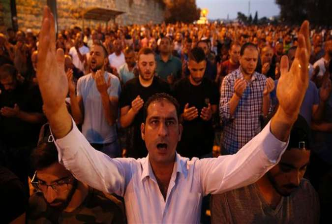 Palestinian Muslim worshippers pray outside Lions