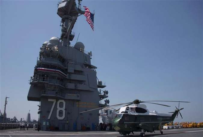 Marine One sits on the flight deck during the commissioning ceremony for the USS Gerald R. Ford in Norfolk, Virginia, on July 22, 2017. (Photo by AFP)