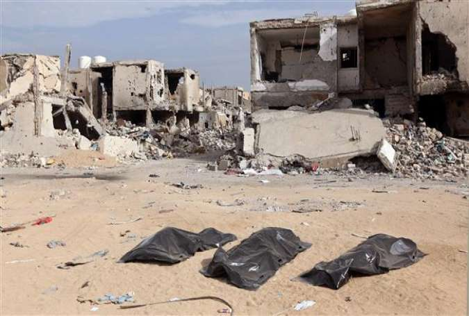 Body bags are seen on the ground after being pulled from under the rubble by the Libyan Red Crescent following clashes in Sirte, Libya, on December 20, 2016. (Photo by AFP)
