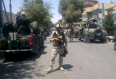Afghan security forces arrive at the site of an explosion near the Iraqi embassy in Kabul