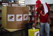 A man casts his vote in Venezuela