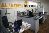 An employee of the Qatar-based news network and TV channel Al Jazeera is seen at the channel