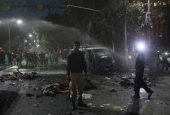 A policeman stands guard at the scene after a blast in Lahore, Pakistan February 13, 2017.