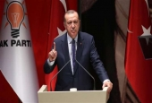 This photo taken on July 01, 2017, shows Turkish President Recep Tayyip Erdogan gesturing as he delivers a speech during the AK Party