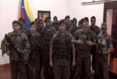 This TV grab taken from a video posted on social media on August 6, 2017 shows a man who allegedly presented himself as army captain Juan Caguaripano at an army base used by the National Bolivarian Armed Forces in the Venezuela's third city of Valencia. (Via AFP)