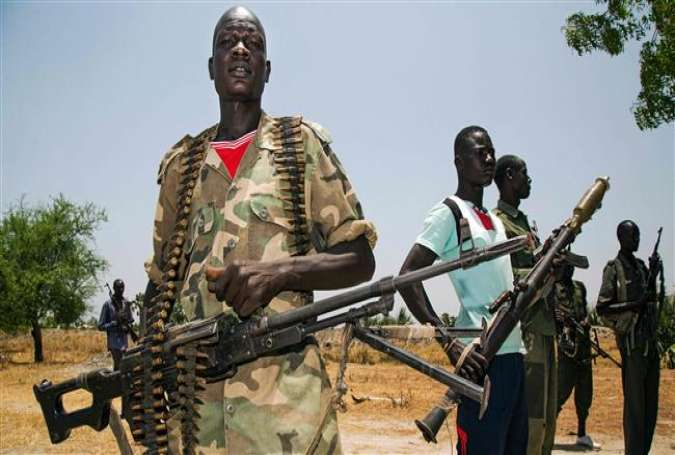 South Sudanese rebels hold weapons near their base at the rebel-held village of Thonyor in Leer County on April 11, 2017. (Photo by AFP)