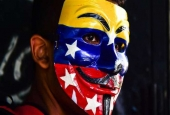 An opposition activist takes part in a protest in Caracas on August 12, 2017. (Photos by AFP)