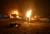 Burning vehicles after bomb blast in Quetta, Pakistan, on Sunday.