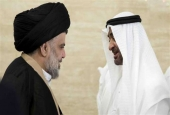 A handout image provided by United Arab Emirates News Agency (WAM) on August 14, 2017 shows Sheikh Mohamed bin Zayed al-Nahyan (R), Abu Dhabi's crown prince, shaking hands with Iraqi cleric Muqtada al-Sadr following a meeting in Abu Dhabi. (Via AFP)