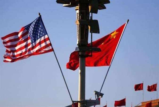 A file photo of the national flags of the US (L) and China (By Reuters)